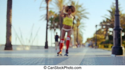Sexy Roller Girl Skating on Exotic Promenade - Sexy Retro...