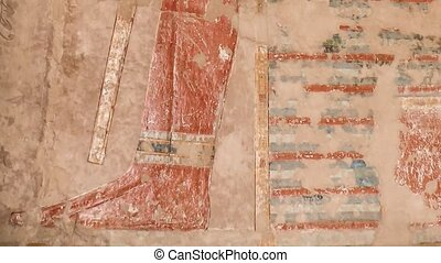 Colored reliefs at the Temple of Hatshepsut at Deir...