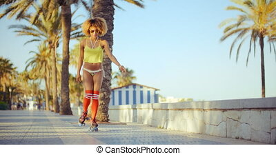 Sexy Shot of Roller Skate Girl Riding on Tropical Beach...