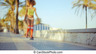 Sexy Low Angle of Roller Skate Girl Riding on Tropical Beach...