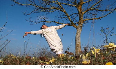 Crazy Woman Sawing Tree Branch - Low angle view of a crazy...