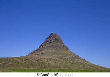Kirkjufell, a high mountain on the north coast of Icelands...