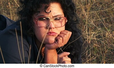 Serious Plus-Sized Woman In Black Lying At The Meadow At...
