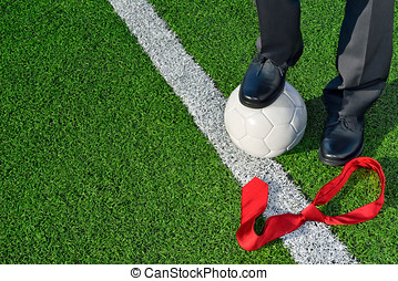 The Coach - Man in suit, standing on a soccer field, one...