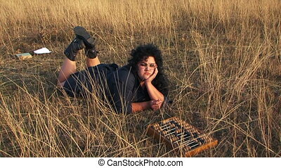 Serious Plus-Sized Woman In Black Lying With Abacus At...