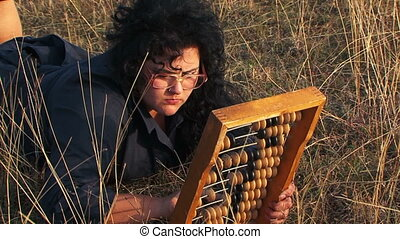 Odd Plus-Sized Woman In Black Playing With Abacus At Nature...