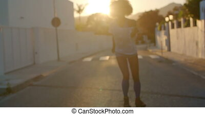 Sexy Roller Skate Girl Riding at Sunset