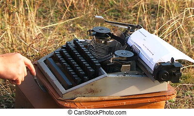 Woman Typing On Vintage Typewriter At Nature - Close-up side...