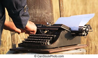 Woman Typing On Manual Vintage Typewriter At Nature -...