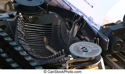 Manual Typewriter Keys Moving When Typing - Macro view of a...