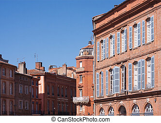 Facades of Toulouse - St. Etienne square in Toulouse, France