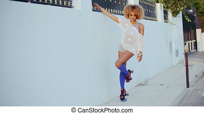 Young Fit Girl Wearing Roller Skates