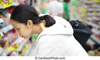 Asian girl shopping in supermarket - Asian girl, woman...
