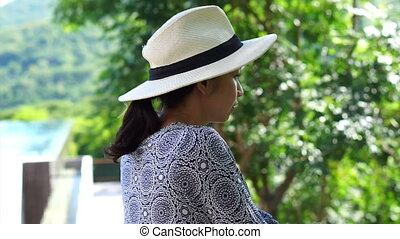 Asian woman in hot tropical nature