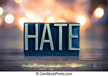 Hate Concept Metal Letterpress Type - The word HATE written...
