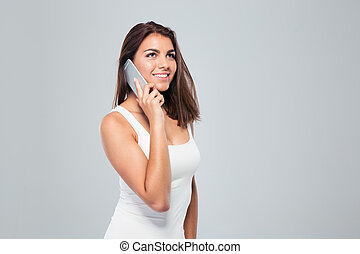 Happy young woman talking on the phone - Portrait of a happy...