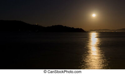 Moon time lapse over the sea