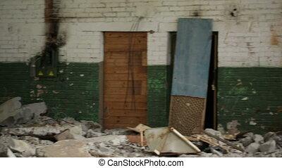 Tumbling door in an abandoned derelict buildings