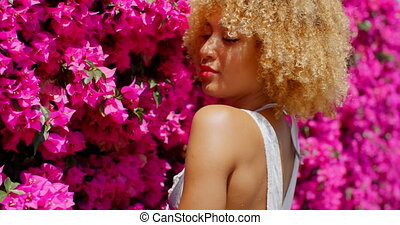 Afro American Girl on Floral Background - Portrait of Afro...