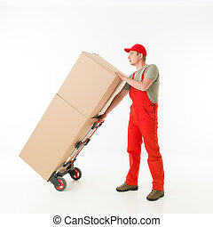 delivery man holding push cart loaded with cardboard boxes,...
