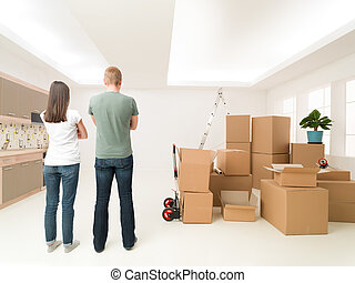 let's start unpacking - rear view of couple standing in new...