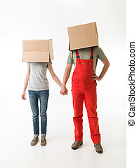 in love with the deliveryman - young couple with cardboard...