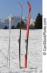 red cross country skiing in the mountains with snow