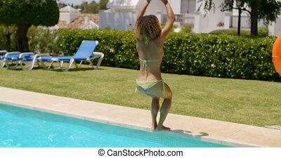 Sexy Girl in Bikini Doing Back Flip into Pool