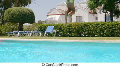 Happy Relaxed Girl Jumping into Swimming Pool - Slow Motion...