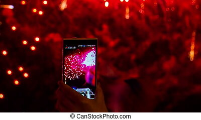 One Person Making A Video Of Fireworks Using Smartphone - In...