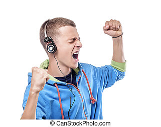 Man listening music with headphones - Casual young man...