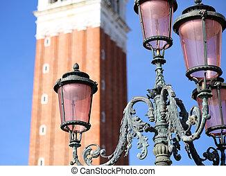 Ancient streetlight in Saint Mark Square in Venice Italy