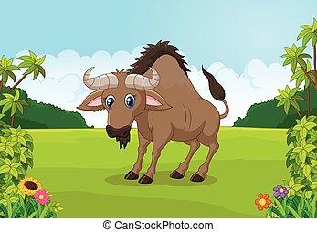 Cartoon animal wildebeest in the ju - Vector illustration of...