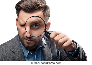 Man with magnifying glass on white background - Man in a...