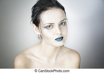 Make-up beautiful young woman close up on gray background.