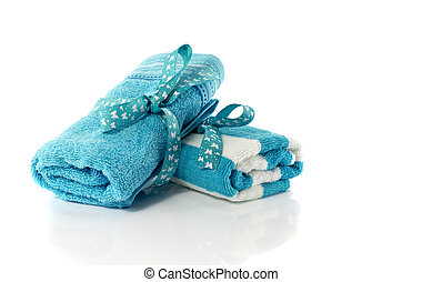 two rolled towels blue and white