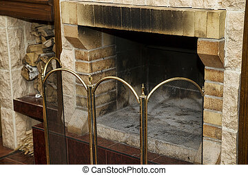 Dirty empty fireplace with firewood