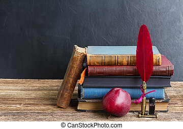 Bookshelf - Wooden bookshelf with antique books, apple and...