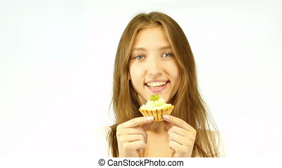 Cheerful girl eating cake - Cheerful woman eating pie, on a...