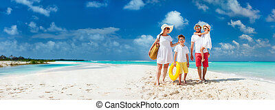 Family on a tropical beach vacation - Panorama of happy...