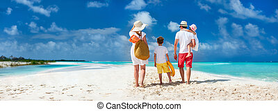 Family with kids on beach vacation - Panorama of a happy...