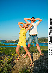 Playful couple in love - Young man and woman on the nature....
