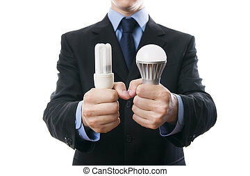 Businessman with fluorescent and LED lamps and incandescent...