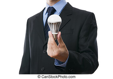 Business man with LED light bulb isolated on a white...