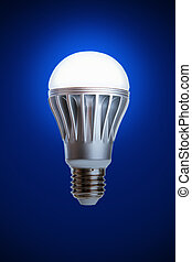 LED light bulb isolated on a blue background