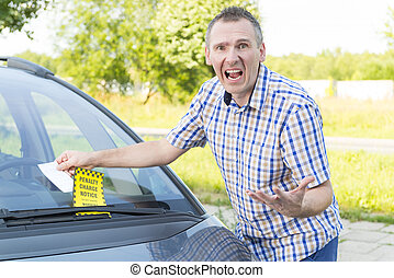 Man with parking ticket - Suprised screaming man looking on...