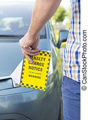 Man holding parking ticket - Man holdig parking ticket in...
