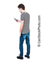 back view of man in suit  talking on mobile phone.