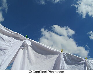 Windy Day - white shirts on a clothes line on a windy day