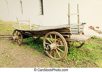 Retro wooden cartToned image - Retro wooden cart in front of...